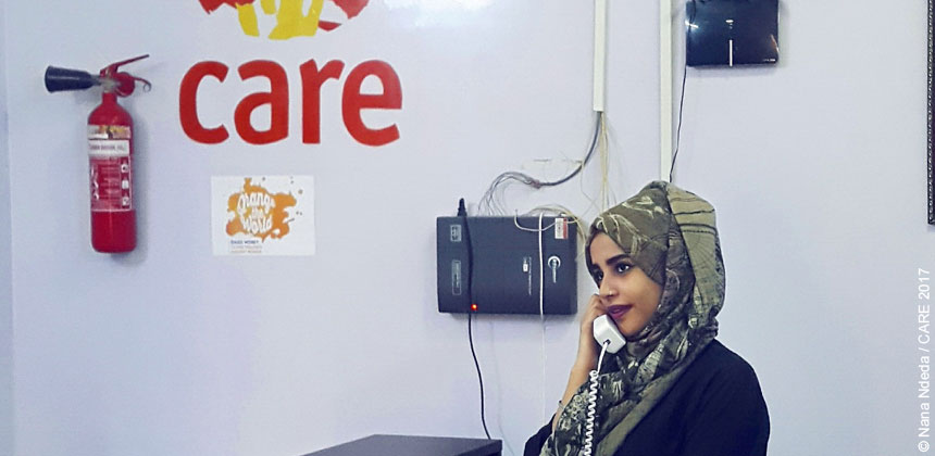 Anhar Saeed in an office