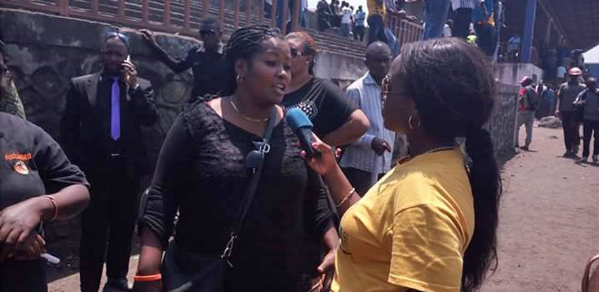 Nelly Mbangu being interviewed