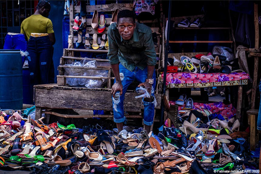Sorie at his shoe stall in Sierra Leone
