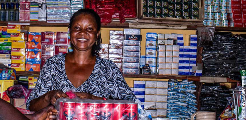 Marian at the counter of her shop in Sierra Leone