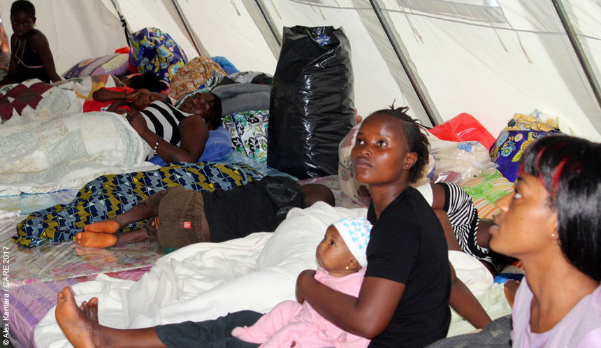 People in a temporary shelter in Sierra Leone