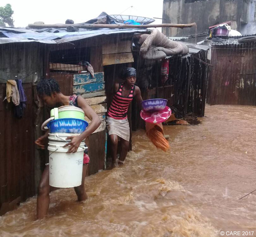 Women leave flooded homes