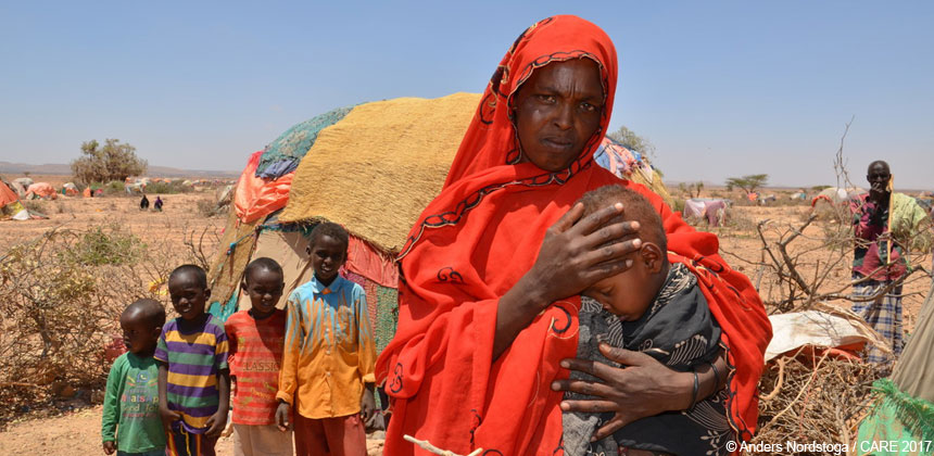 A woman holds her child in Somalia