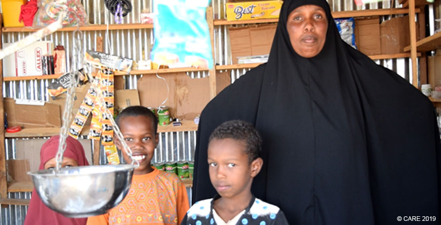 A woman and her children inside village shop in Somalia