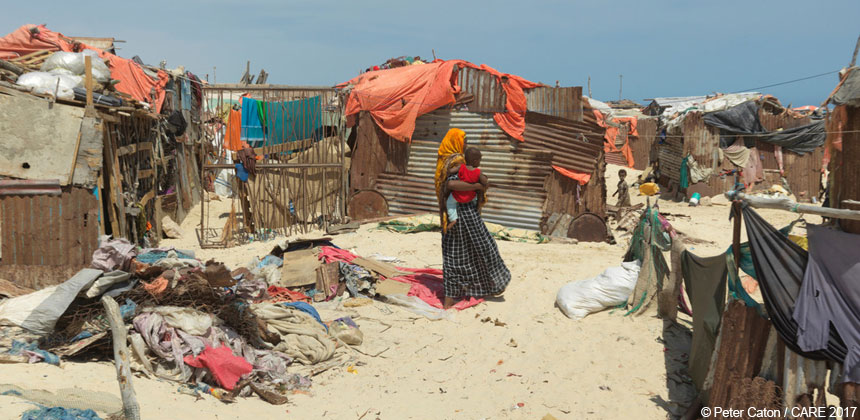 Woman and shelters at IDP camp in Bosaso