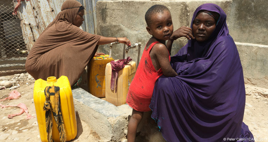 Women and child collecting water in Somalia