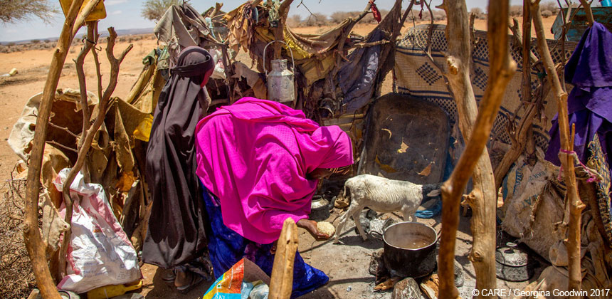 Amina preparing rice distributed by CARE