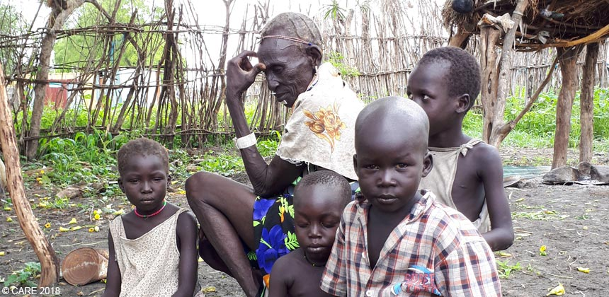 Woman with her four grandchildren in South Sudan