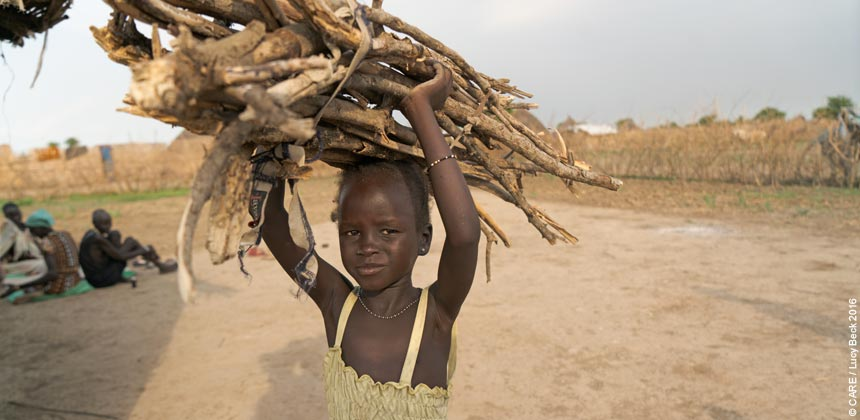 Zeieya carrying a bunch of firewood
