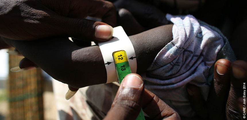 A child's arm being tested for malnutrition