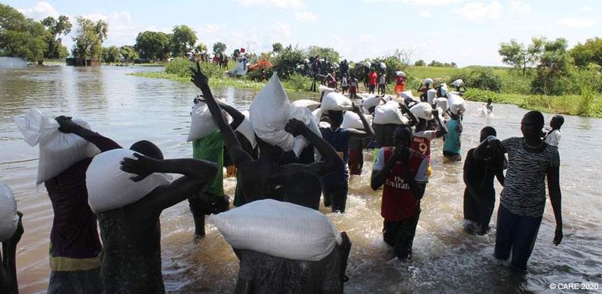 People wading across floods in South Sudan