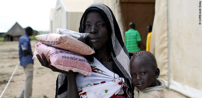 A woman and child with packets of seeds in South Sudan
