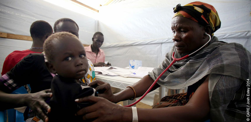 A health worker examining a child in South Sudan