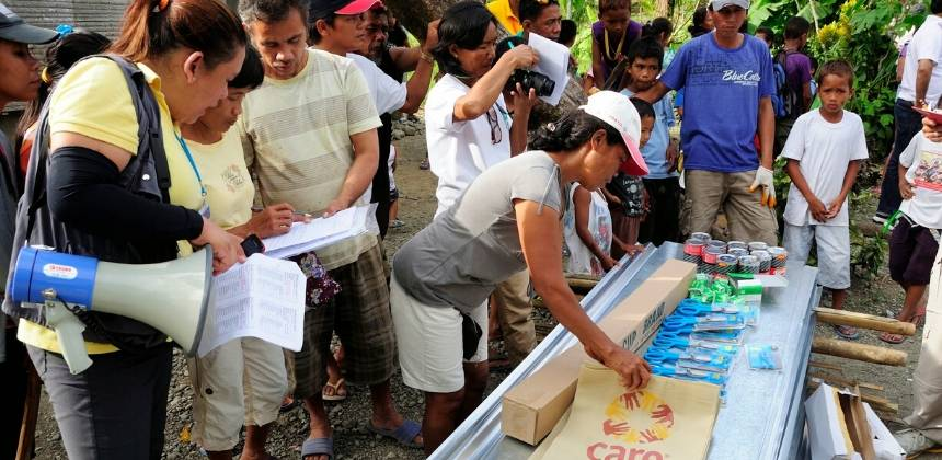 CARE distribute shelter kits in Malinao, Aklan ( Panay Island) funded by DEC.