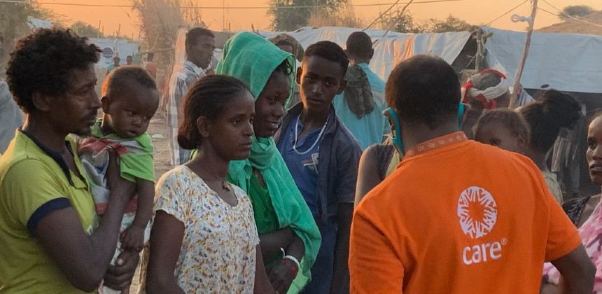 CARE staff talks to refugees in Sudan