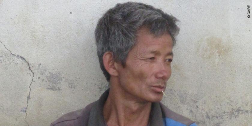 Sup Yonjan who recently received three kilograms of rice seeds from CARE