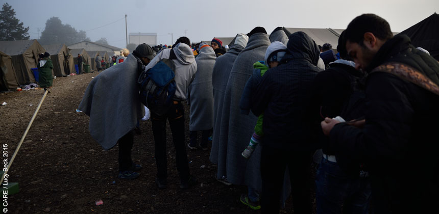 People queuing huddled in blankets