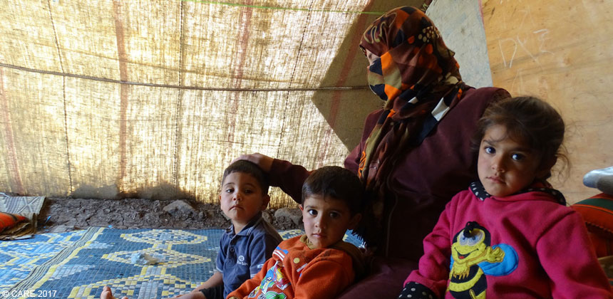 Amani with children inside tent in Syria