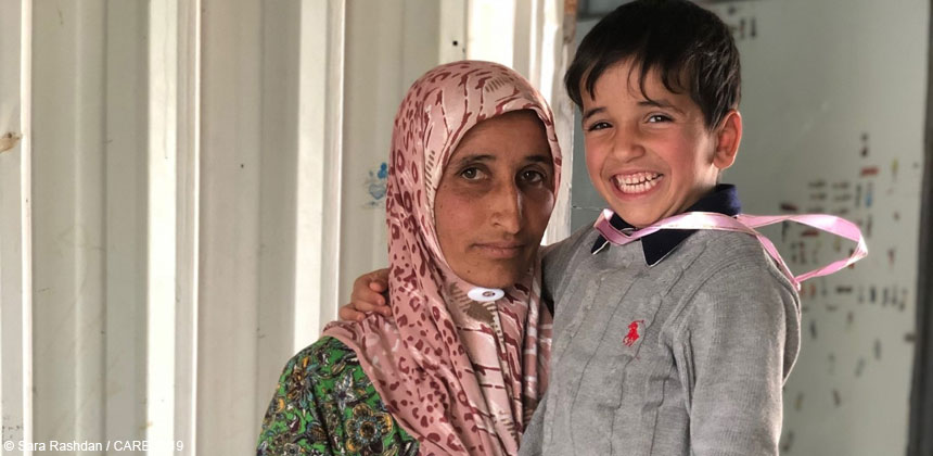 Aysha and her youngest son at Azraq camp