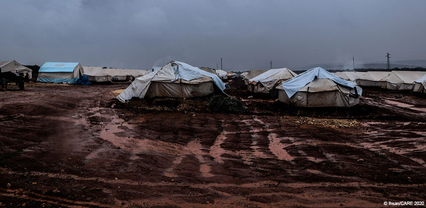 Tents in a muddy field in northwest Syria