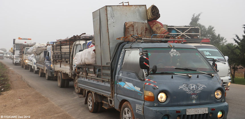Trucks carrying people and their belongings in Syria