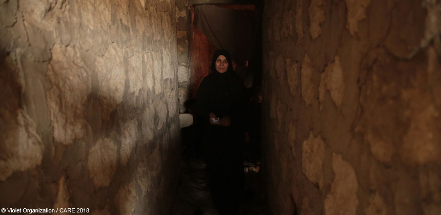 Um Mohammed in a corridor in her home in Syria