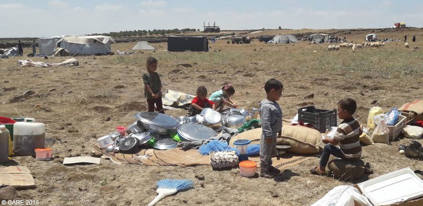 Children at temporary camp in field in Syria