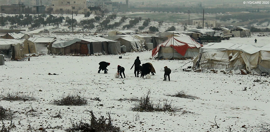 Syrian children playing in snow at displaced persons camp