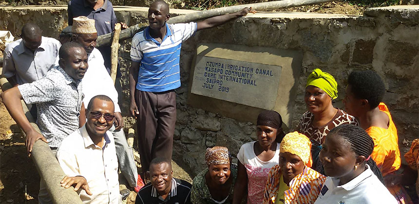 People at newly constructed irrigation storage at village in Tanzania