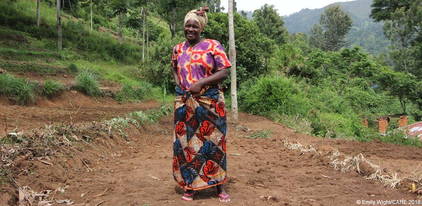 Rose, a farmer in Tanzania, on her terraced field