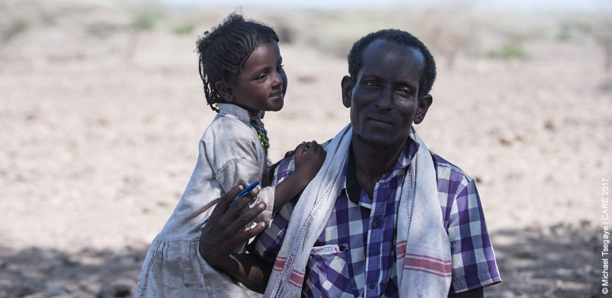 Awalo, a community leader in Ethiopia, with his daughter