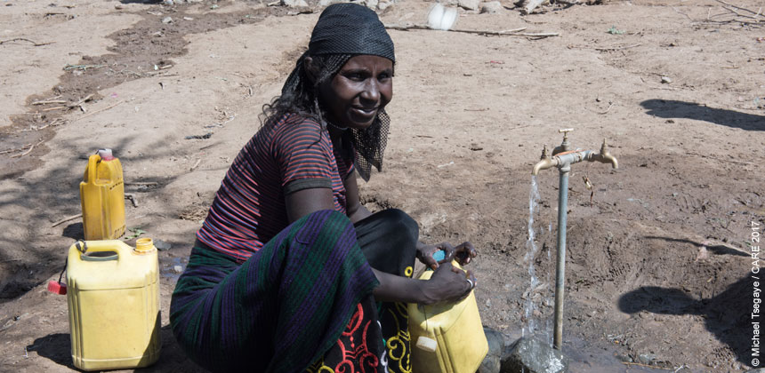 Woman in Ethiopia collecting water from a tap