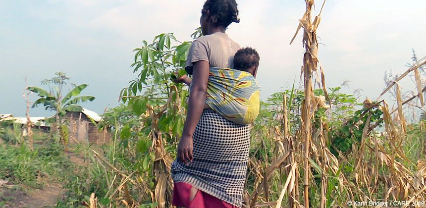 Cecile, a refugee from the DRC, walking with her baby