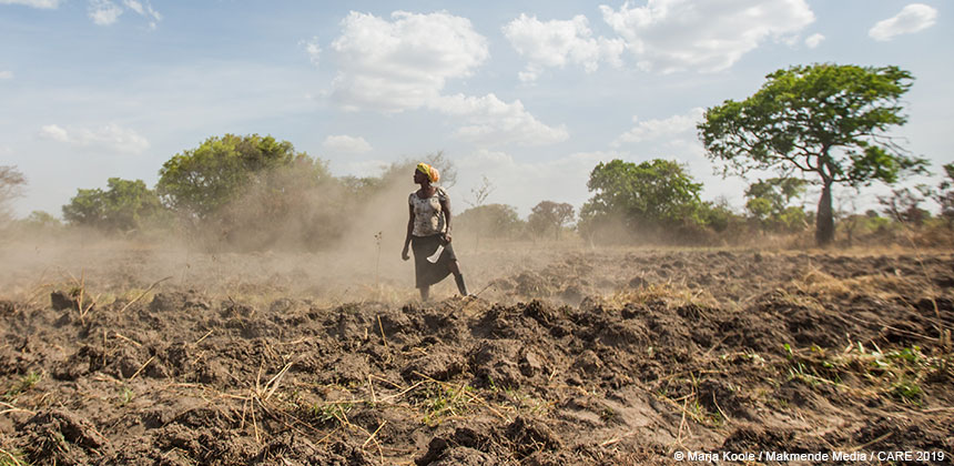Kelle Anyes, farmer, in a ploughed field in Uganda