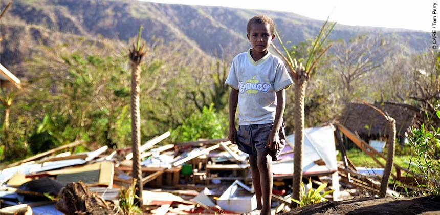Boy stands in wreckage of school destroyed by the cyclone, Tanna island