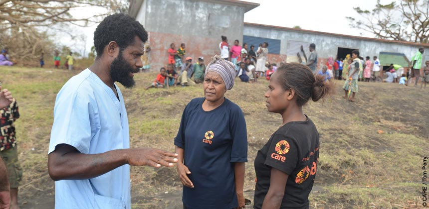 CARE staff talking to a medical colleague in Vanuatu