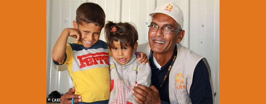 Yousef Al Filali, CARE Jordan, with two children
