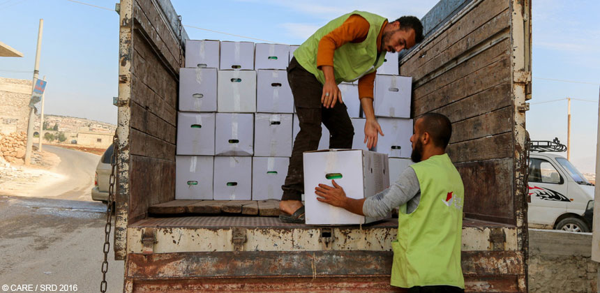 Relief workers unload boxes of aid in Syria