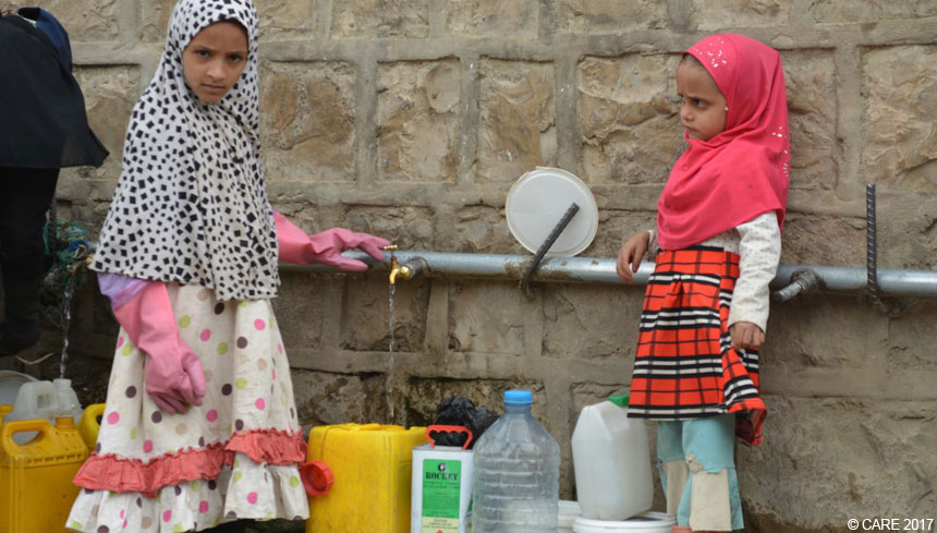 Young girls at a water collection point in Yemen