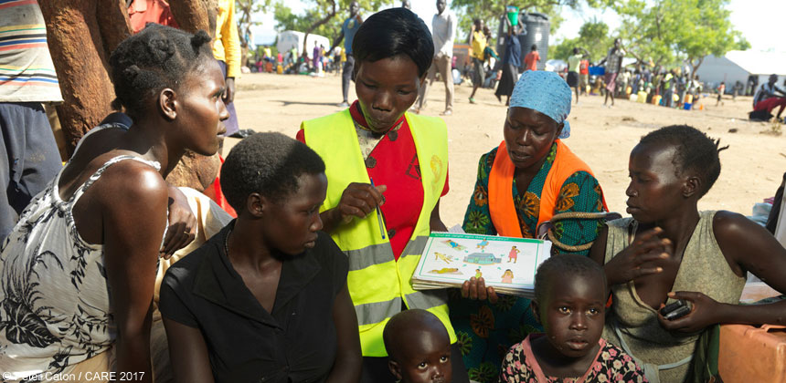 Midwife Mary Maturu talking to refugees