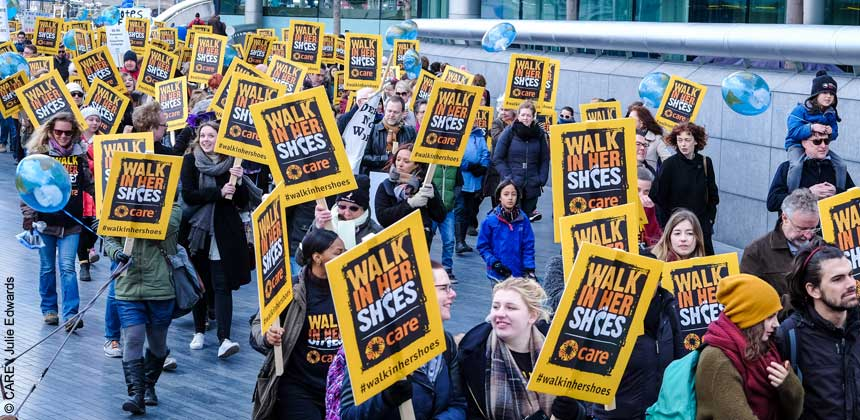 People marching with Walk In Her Shoes placards