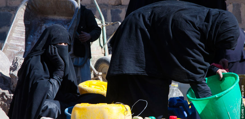 Women with jerry cans and buckets for collecting water