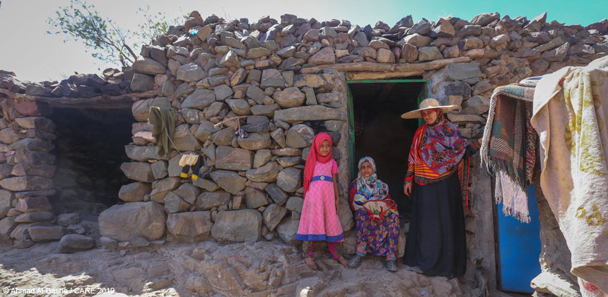 Kawather and children outside their home, Yemen