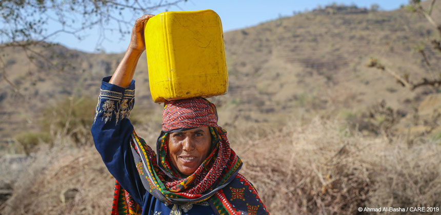 Portrait of Shafeqa holding water canister, Yemen
