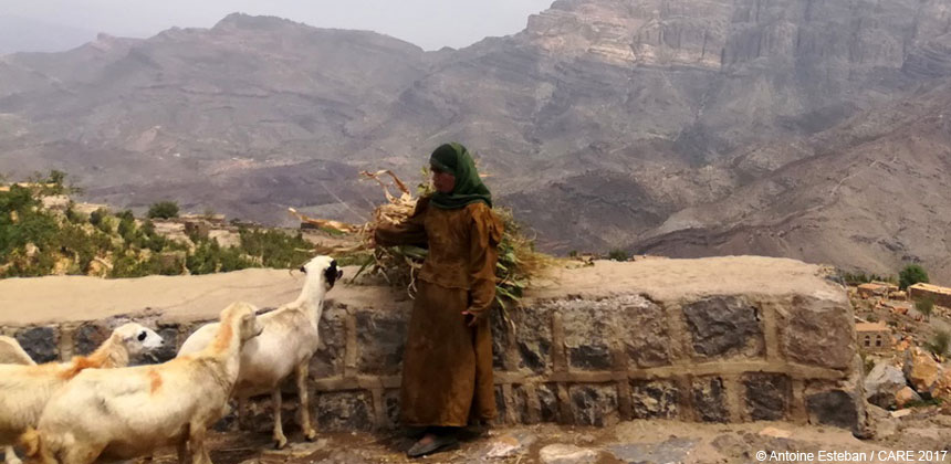 A woman with her goats in Yemen