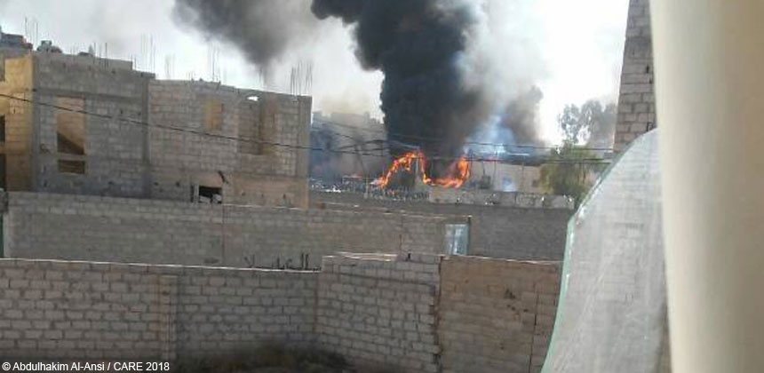 Fire from a bombed building in Yemen