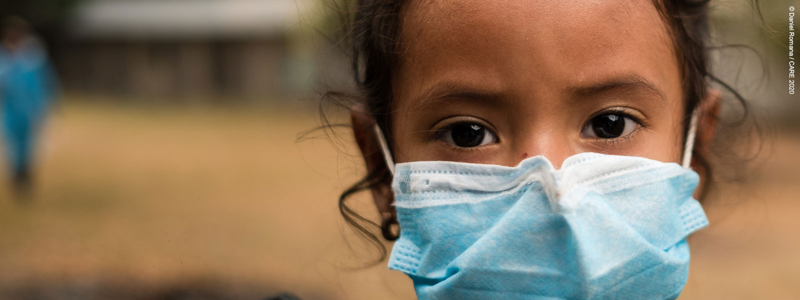 A young girl in Honduras, wearing face mask