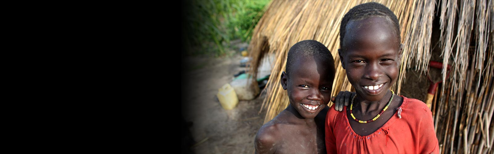 Two smiling children in South Sudan