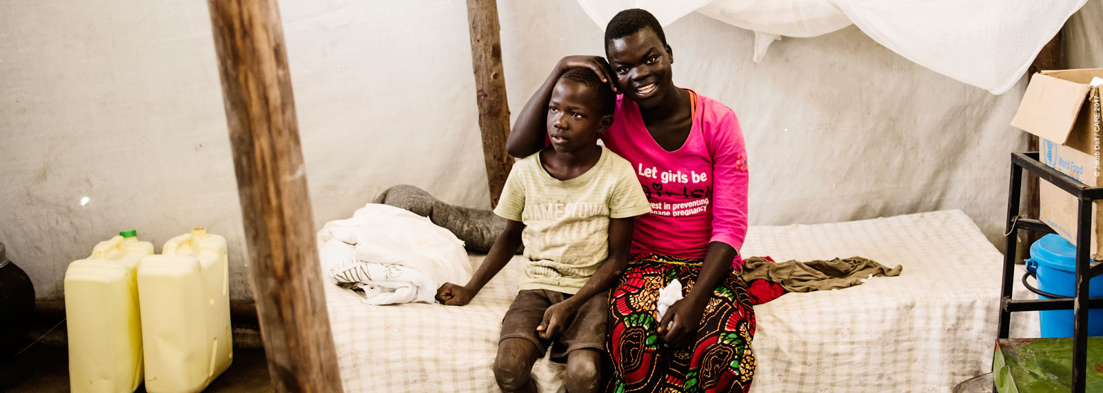 South Sudanese refugee girl and boy in a tent in Uganda refugee camp