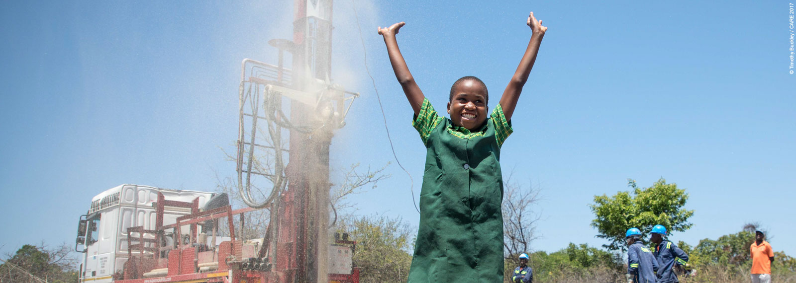 Precious celebrating at water borehole